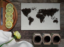 Map of the world, lined with tea leaves on old paper. Eurasia, America, Australia, Africa. vintage. tea, a towel, rose Stock Photos