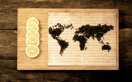 Map of the world, lined with tea leaves on old paper.  Stock Image