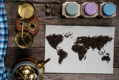 Map of the world, lined with tea leaves on old paper. vintage. green tea, a towel, a cup of tea, scales, weights and tea Stock Photography
