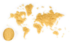 Map of the world made of cane sugar on white background. With white ceramic bowl full of cane sugar stock image