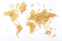 Map of the world made of raw natural rice on white background Stock Photography