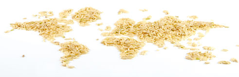 Map of the world made of raw natural rice on white background Stock Images