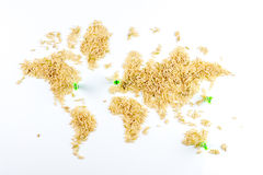 Map of the world made of raw natural rice on white background Stock Photo