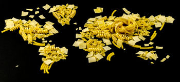 Map of the world made of raw pasta on black background Royalty Free Stock Image