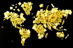 Map of the world made of raw pasta on black background Royalty Free Stock Images