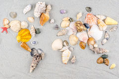 Map of the world made of shells on sand Royalty Free Stock Photos
