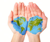 Map of world painted on hands. Isolated on white background Royalty Free Stock Photo