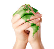 Map of world painted on hands Stock Photo
