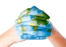 Map of world painted on hands. Isolated on white background Royalty Free Stock Images