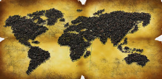 Map of world from tea on old paper stock photos