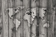 Map of the world on weathered wood Royalty Free Stock Images