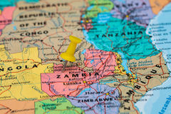 Map of Zambia with a yellow pushpin stuck Royalty Free Stock Images