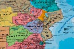 Map of Zimbabwe with a orange pushpin stuck Stock Image