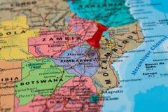Map of Zimbabwe with a red pushpin stuck Stock Image