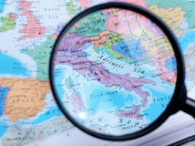 Map and Zoom Lens, Italy Royalty Free Stock Images