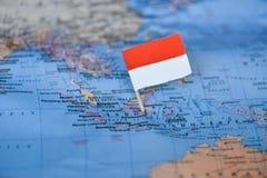 Mapa com a bandeira de Indonésia fotos de stock