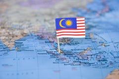 Mapa com a bandeira de Mal?sia fotografia de stock royalty free