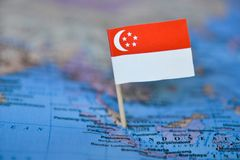 Mapa com a bandeira de Singapura imagens de stock