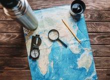 Mapa con una lupa Imagen de archivo