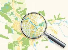 Mapa da cidade e de uma lupa Fotos de Stock Royalty Free