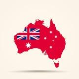 Mapa de Australia en la bandera civil del En australiano del rojo de Australia Fotografía de archivo libre de regalías