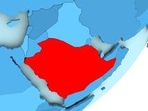Mapa de la Arabia Saudita en el globo político azul Stock de ilustración