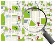 Mapa de la navegación de la ciudad con la lupa Imágenes de archivo libres de regalías