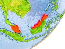 Mapa de Malásia na terra Fotografia de Stock