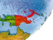 Mapa de Papúa Nueva Guinea en la tierra Imágenes de archivo libres de regalías