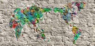 Mapa del mundo con las manos en diversos colores Foto de archivo libre de regalías