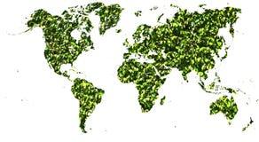 Mapa del mundo cortado en hojas verdes fotografía de archivo