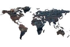 Mapa del mundo en el fondo de la madera quemada Foto de archivo libre de regalías