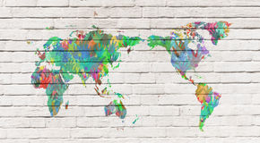 Mapa do mundo com mãos em cores diferentes Fotos de Stock