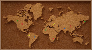 Mapa do mundo da placa da cortiça Foto de Stock