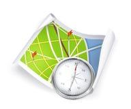 Mapa e compasso de estrada Fotografia de Stock Royalty Free