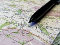 Mapa e lápis Imagem de Stock Royalty Free