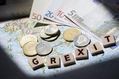 Mapa, euro e letras gregos do grexit do dracma Imagens de Stock