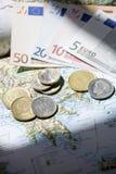 Mapa Grecja z euro i drachmą na nim Fotografia Royalty Free