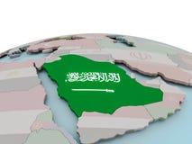 Mapa político de la Arabia Saudita en el globo con la bandera Foto de archivo