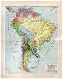 Mapa viejo de Suramérica con la lupa Imagen de archivo libre de regalías