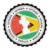 Mapa y bandera de Guyana en sello de goma del vintage de imagen de archivo