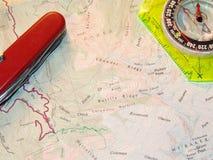 Mapa y compás Foto de archivo
