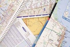 Mapas dobrados do curso Fotos de Stock Royalty Free