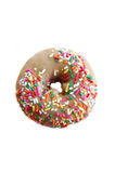 Maple Donut with Sprinkles. A donut with maple icing and colorful sprinkles Royalty Free Stock Image