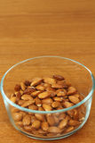 Maple Glazed Almonds in a Glass Bowl Stock Image