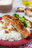 Maple glazed salmon with caramelized onions and rice Royalty Free Stock Image