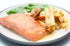 Maple glazed salmon fillet with french fries and snap peas, full Stock Photos