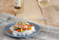 Maple glazed salmon with stir-fry vegetables. And rice Stock Image