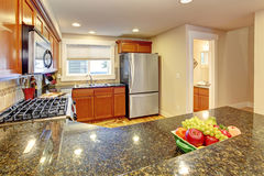 Maple kitchen cabinets with granite tops Royalty Free Stock Photos