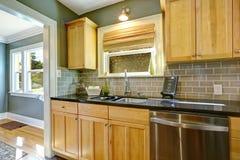 Maple kitchen cabinets with tile back splash trim Stock Image